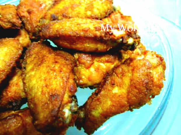 Fried chicken wing with preserved red tofu cubes