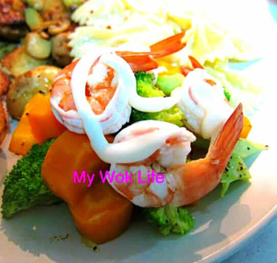 Prawn salad on bed of cheesy vegetables