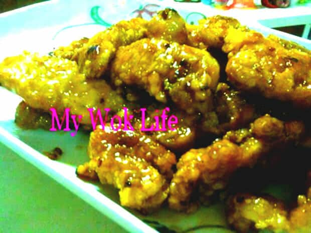 Fried fish fillet in lemon sauce